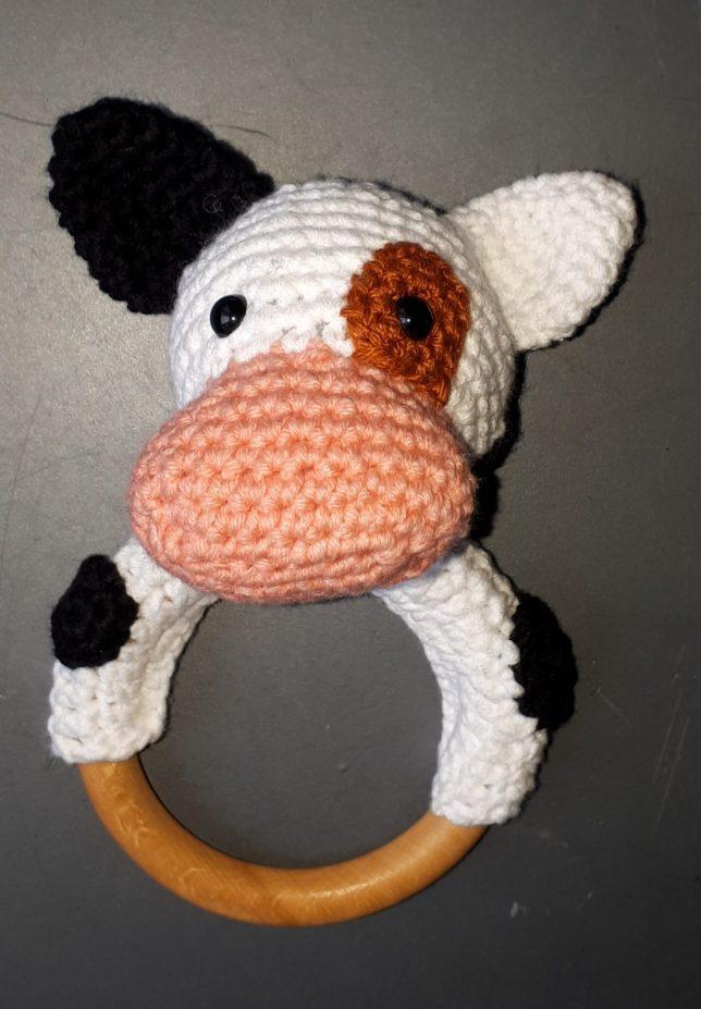 rammelaar met een koe